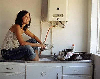 Woman Enjoying the Benefits Of A Point-Of-Use Water Heater